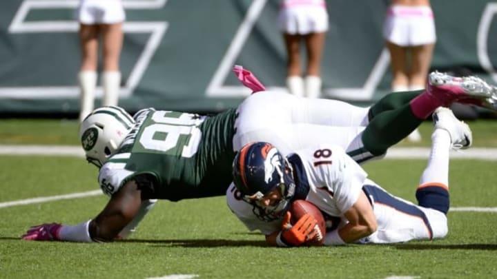 Oct 12, 2014; East Rutherford, NJ, USA; New York Jets defensive end Muhammad Wilkerson (96) sacks Denver Broncos quarterback Peyton Manning (18) during the first half at MetLife Stadium. Mandatory Credit: Robert Deutsch-USA TODAY Sports