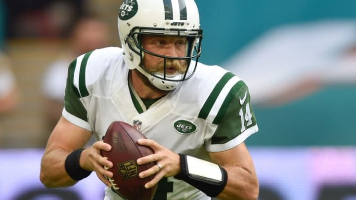 Oct 4, 2015; London, ENG; New York Jets quarterback Ryan Fitzpatrick (14) looks for a pass during the first half of the game against the Miami Dolphins at Wembley Stadium. Mandatory Credit: Steve Flynn-USA TODAY Sports