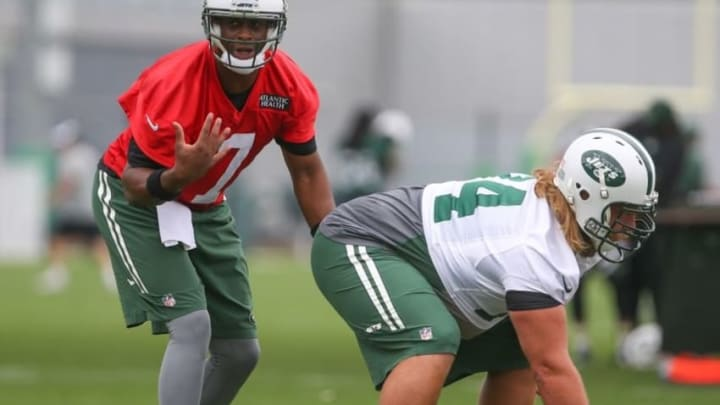 May 27, 2015; East Rutherford, NJ, USA; New York Jets quarterback Geno Smith (7) gets ready to take the snap from New York Jets center Nick Mangold (74) during organized team activities at Atlantic Health Jets Training Center. Mandatory Credit: Ed Mulholland-USA TODAY Sports