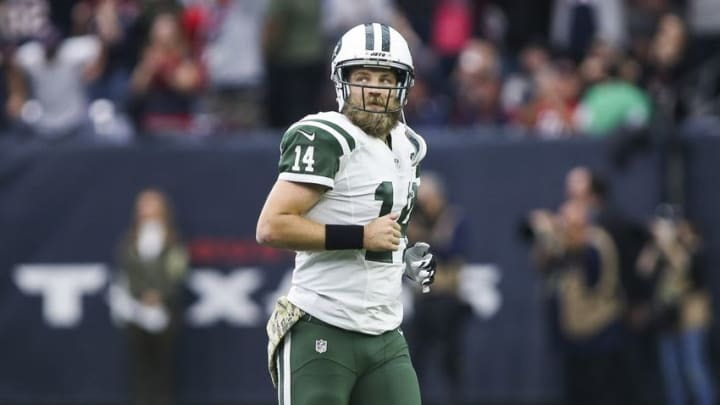 Nov 22, 2015; Houston, TX, USA; New York Jets quarterback Ryan Fitzpatrick (14) in the pocket during the second half of a game against the Houston Texans at NRG Stadium. Houston won 24-17. Mandatory Credit: Ray Carlin-USA TODAY Sports