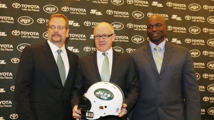 Jan 21, 2015; Florham Park, NJ, USA; New York Jets new general manager Mike Maccagnan (left), owner Woody Johnson (center), and new head coach Todd Bowles (right) pose for a photo during a press conference at Atlantic Health Jets Training Center. Mandatory Credit: William Perlman/NJ Advance Media for NJ.com via USA TODAY Sports