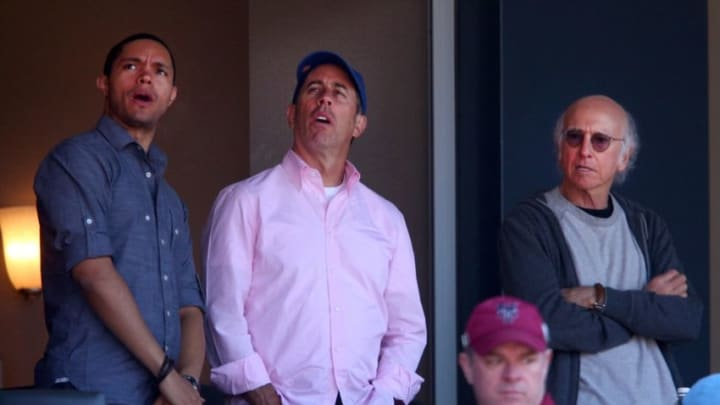 Apr 13, 2015; New York City, NY, USA; Celebrity comedians Trevor Noah (left) and Jerry Seinfeld (center) and Larry David (right) watch an opening day game between the New York Mets and the Philadelphia Phillies at Citi Field. The Mets defeated the Phillies 2-0. Mandatory Credit: Brad Penner-USA TODAY Sports