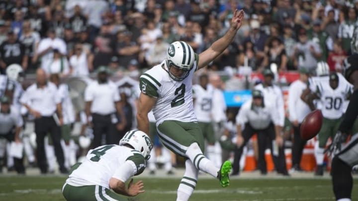 November 1, 2015; Oakland, CA, USA; New York Jets kicker Nick Folk (2) kicks a field goal out of the hold by punter Ryan Quigley (4) against the Oakland Raiders during the first quarter at O.co Coliseum. Mandatory Credit: Kyle Terada-USA TODAY Sports