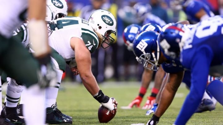 Dec 6, 2015; East Rutherford, NJ, USA; New York Jets center Nick Mangold (74) snaps the ball against the New York Giants during overtime at MetLife Stadium. The Jets defeated the Giants 23-20 in overtime. Mandatory Credit: Brad Penner-USA TODAY Sports