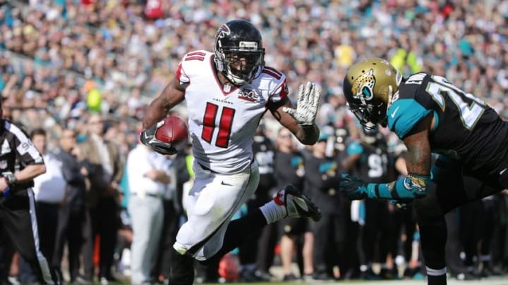 Dec 20, 2015; Jacksonville, FL, USA; Atlanta Falcons wide receiver Julio Jones (11) runs the ball in for a touchdown against the Jacksonville Jaguars during the first half at EverBank Field. Mandatory Credit: Kim Klement-USA TODAY Sports