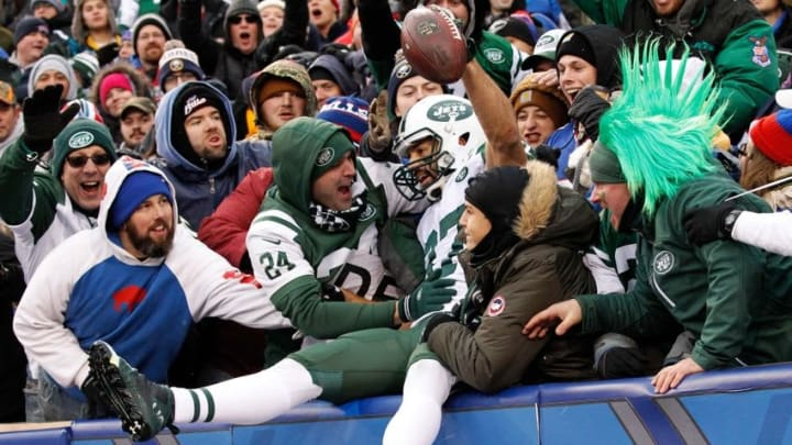 Jan 3, 2016; Orchard Park, NY, USA; New York Jets fans surround New York Jets wide receiver Eric Decker (87) after he scored a touchdown against the Buffalo Bills at Ralph Wilson Stadium. Mandatory Credit: Kevin Hoffman-USA TODAY Sports