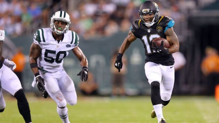 Aug 11, 2016; East Rutherford, NJ, USA; Jacksonville Jaguars wide receiver Tony Washington (12) runs for a big gain ahead of New York Jets outside linebacker Darron Lee (50) during the second quarter of a preseason game at MetLife Stadium. Mandatory Credit: Brad Penner-USA TODAY Sports