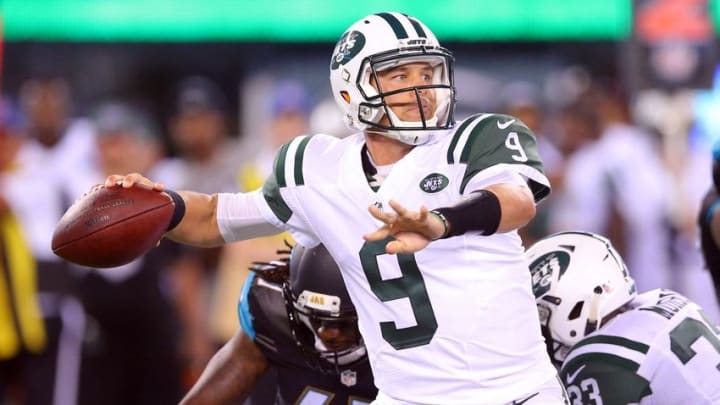 Aug 11, 2016; East Rutherford, NJ, USA; New York Jets quarterback Bryce Petty (9) drops back to pass with pressure by Jacksonville Jaguars defensive back Jarrod Wilson (47) during the third quarter of a preseason game at MetLife Stadium. Mandatory Credit: Brad Penner-USA TODAY Sports