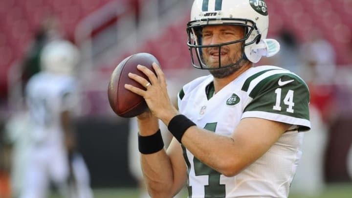 Aug 19, 2016; Landover, MD, USA; New York Jets quarterback Ryan Fitzpatrick (14) on the field before the game between the Washington Redskins and the New York Jets at FedEx Field. Mandatory Credit: Brad Mills-USA TODAY Sports