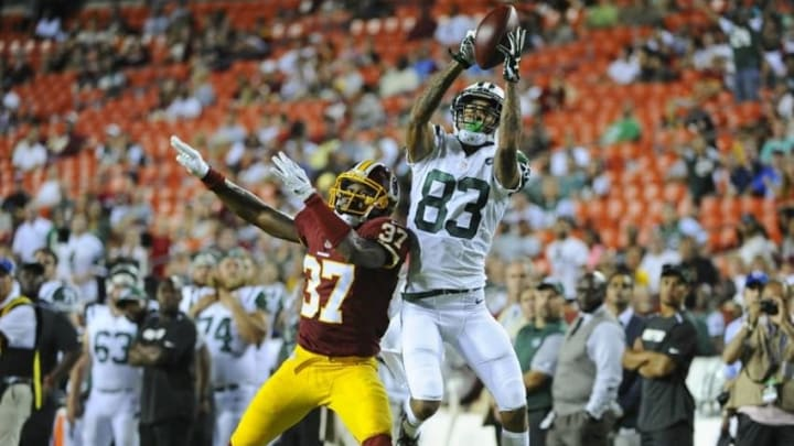 Aug 19, 2016; Landover, MD, USA; New York Jets wide receiver Robby Anderson (83) scores a touchdown as Washington Redskins defensive back Jeremy Harris (37) defends during the second half at FedEx Field. Mandatory Credit: Brad Mills-USA TODAY Sports