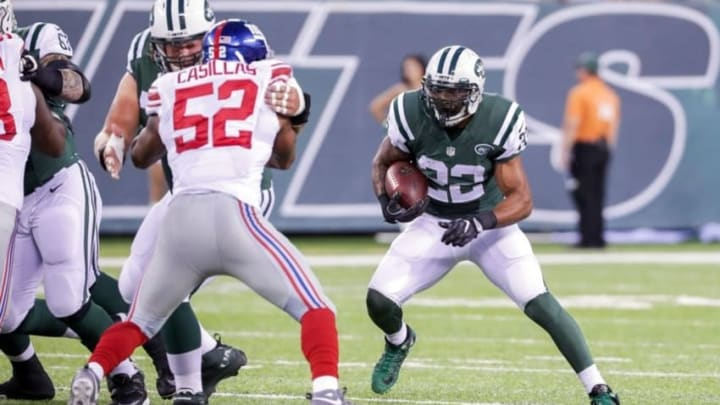 Aug 27, 2016; East Rutherford, NJ, USA; New York Jets running back Matt Forte (22) rushes the ball against the New York Giants during the first quarter of the preseason game at MetLife Stadium. Mandatory Credit: Vincent Carchietta-USA TODAY Sports