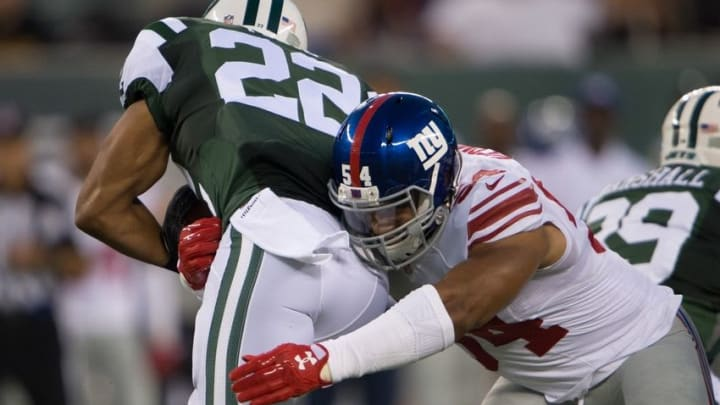 Aug 27, 2016; East Rutherford, NJ, USA;New York Giants defensive end Olivier Vernon (54) tackles New York Jets running back Matt Forte (22) in the 1st half at MetLife Stadium. Mandatory Credit: William Hauser-USA TODAY Sports