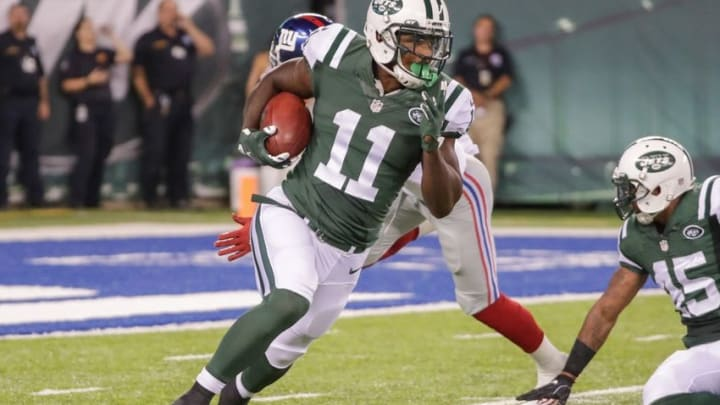 Aug 27, 2016; East Rutherford, NJ, USA; New York Jets wide receiver Jeremy Ross (11) returns a punt against the New York Giants during the first half at MetLife Stadium. Mandatory Credit: Vincent Carchietta-USA TODAY Sports