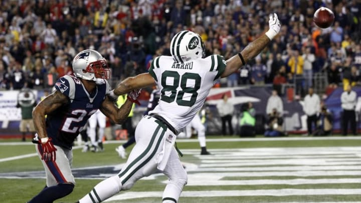 Oct 16, 2014; Foxborough, MA, USA; New York Jets tight end Jace Amaro (88) reaches for a pass against New England Patriots strong safety Patrick Chung (23) during the second half at Gillette Stadium. Mandatory Credit: Mark L. Baer-USA TODAY Sports