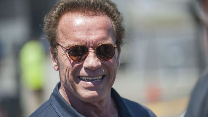 Jun 28, 2015; Sonoma, CA, USA; Actor and politician Arnold Schwarzenegger smiles for fans before the Toyota/SaveMart 350 at Sonoma Raceway. Mandatory Credit: Ed Szczepanski-USA TODAY Sports