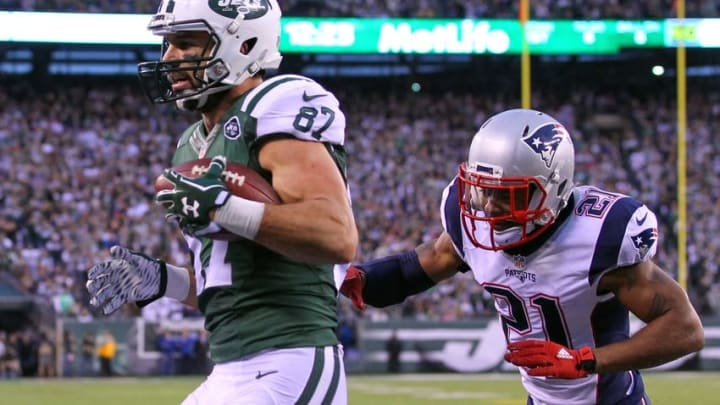 Dec 27, 2015; East Rutherford, NJ, USA; New York Jets wide receiver Eric Decker (87) catches a game winning touchdown pass from New York Jets quarterback Ryan Fitzpatrick (14) (not shown) during overtime at MetLife Stadium. The Jets defeated the Patriots 26-20. Mandatory Credit: Ed Mulholland-USA TODAY Sports