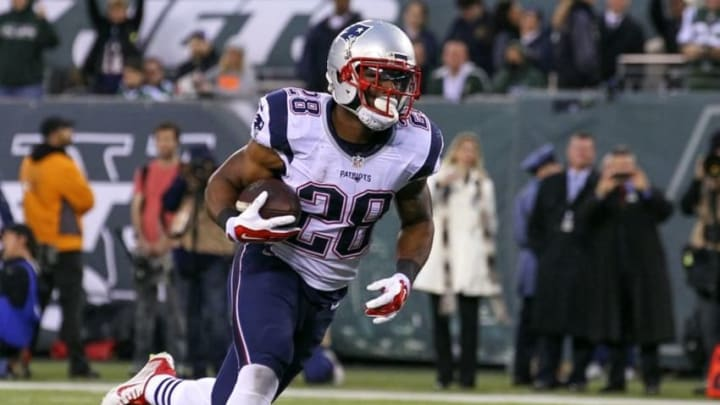 Dec 27, 2015; East Rutherford, NJ, USA; New England Patriots cornerback Darryl Roberts (28) runs for a touchdown during the second half at MetLife Stadium. The Jets defeated the Patriots 26-20. Mandatory Credit: Ed Mulholland-USA TODAY Sports
