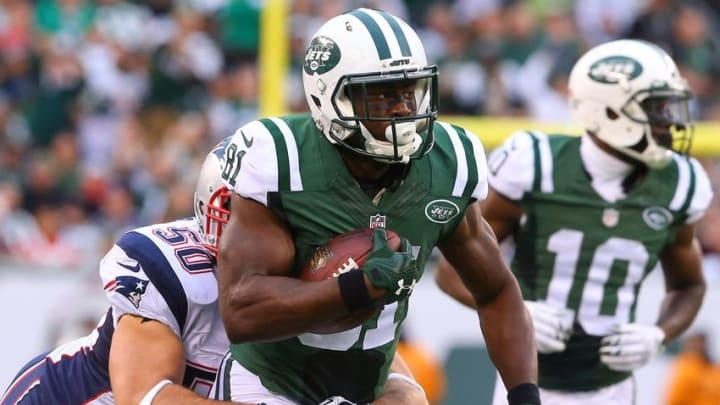 Dec 27, 2015; East Rutherford, NJ, USA; New York Jets wide receiver Quincy Enunwa (81) runs with the ball while New England Patriots defensive end Rob Ninkovich (50) attempts to tackle him during the second half at MetLife Stadium. The Jets defeated the Patriots 26-20 in overtime. Mandatory Credit: Ed Mulholland-USA TODAY Sports