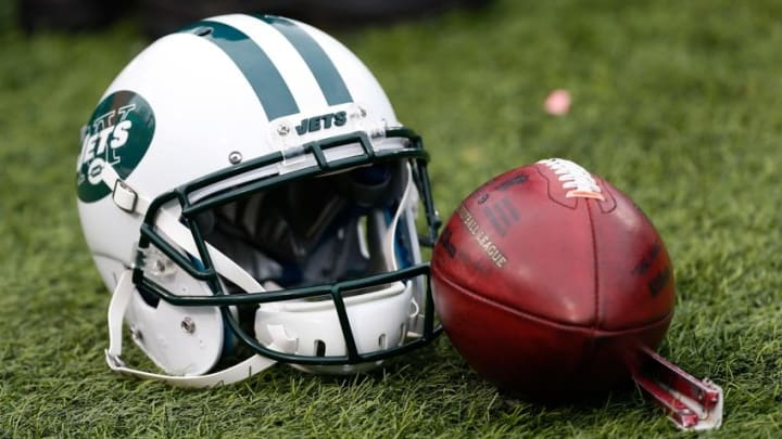 Jan 3, 2016; Orchard Park, NY, USA; A general view of a New York Jets helmet and an NFL football during the game between the Buffalo Bills and the New York Jets at Ralph Wilson Stadium. Mandatory Credit: Kevin Hoffman-USA TODAY Sports