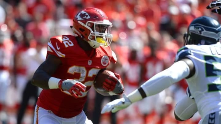 Aug 13, 2016; Kansas City, MO, USA; Kansas City Chiefs running back Spencer Ware (32) carries the ball against the Seattle Seahawks in the first half at Arrowhead Stadium. Mandatory Credit: John Rieger-USA TODAY Sports