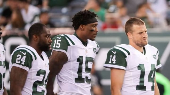 Aug 11, 2016; East Rutherford, NJ, USA; New York Jets cornerback Darrelle Revis (24) and wide receiver Devin Smith (19) and quarterback Ryan Fitzpatrick (14) before the preseason game against the Jacksonville Jaguars at MetLife Stadium. The Jets won, 17-13. Mandatory Credit: Vincent Carchietta-USA TODAY Sports
