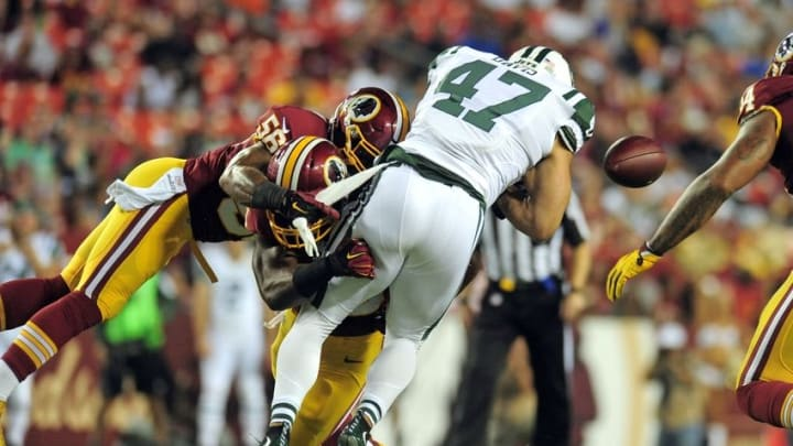 Aug 19, 2016; Landover, MD, USA; New York Jets tight end Kellen Davis (47) fumbles on a hit by Washington Redskins linebacker Perry Riley Jr. (56) in the second quarter at FedEx Field. Mandatory Credit: Evan Habeeb-USA TODAY Sports