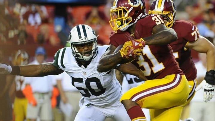 Aug 19, 2016; Landover, MD, USA; Washington Redskins running back Matt Jones (31) rushes the ball as New York Jets outside linebacker Darron Lee (50) looks on during the first half at FedEx Field. Mandatory Credit: Brad Mills-USA TODAY Sports
