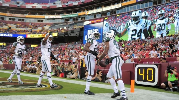Aug 19, 2016; Landover, MD, USA; New York Jets cornerback Darrelle Revis (24) celebrates with teammates after making an interception in the first quarter against the Washington Redskins at FedEx Field. Mandatory Credit: Evan Habeeb-USA TODAY Sports