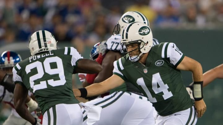 Aug 27, 2016; East Rutherford, NJ, USA;New York Jets quarterback Ryan Fitzpatrick (14) hands the ball off to New York Jets running back Bilal Powell (29) in the 1st half at MetLife Stadium. Mandatory Credit: William Hauser-USA TODAY Sports