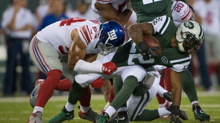 Aug 27, 2016; East Rutherford, NJ, USA;New York Giants defensive end Olivier Vernon (54) drags down New York Jets running back Matt Forte (22) in the 1st half at MetLife Stadium. Mandatory Credit: William Hauser-USA TODAY Sports