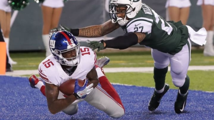 Aug 27, 2016; East Rutherford, NJ, USA; New York Giants wide receiver Tavarres King (15) catches a touchdown pass in front of New York Jets cornerback Dee Milliner (27) during the second half at MetLife Stadium. The Giants won 21-20. Mandatory Credit: Vincent Carchietta-USA TODAY Sports