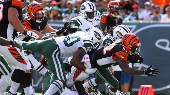 Sep 11, 2016; East Rutherford, NJ, USA; Cincinnati Bengals running back Jeremy Hill (32) scores a touchdown against New York Jets corner back Marcus Williams (20) and linebacker Darron Lee (50) during the third quarter at MetLife Stadium. Mandatory Credit: Brad Penner-USA TODAY Sports