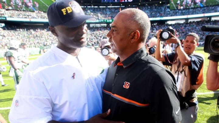 Sep 11, 2016; East Rutherford, NJ, USA; New York Jets head coach Todd Bowles (left) and Cincinnati Bengals head coach Marvin Lewis meet at midfield after a game at MetLife Stadium. Mandatory Credit: Brad Penner-USA TODAY Sports