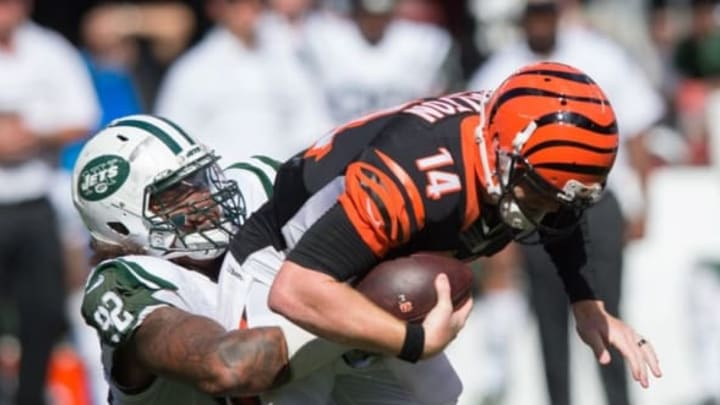 Sep 11, 2016; East Rutherford, NJ, USA; New York Jets defensive tackle Leonard Williams (92) sacks Cincinnati Bengals quarterback Andy Dalton (14) in the second half at MetLife Stadium. The Bengals defeated the Jets 23-22. Mandatory Credit: William Hauser-USA TODAY Sports