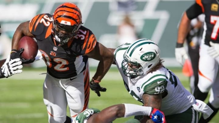 Sep 11, 2016; East Rutherford, NJ, USA; New York Jets defensive tackle Leonard Williams (92) and defensive end Muhammad Wilkerson (96) tackle Cincinnati Bengals running back Jeremy Hill (32) in the second half at MetLife Stadium. The Bengals defeated the Jets 23-22. Mandatory Credit: William Hauser-USA TODAY Sports