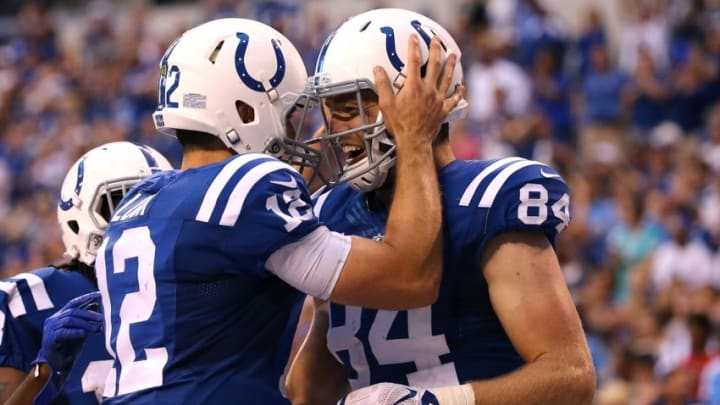 Sep 11, 2016; Indianapolis, IN, USA; Indianapolis Colts quarterback Andrew Luck (12) celebrates throwing a touchdown pass to tight end Jack Doyle (84) in the second half against the Detroit Lions at Lucas Oil Stadium. The Lions won 39-35. Mandatory Credit: Aaron Doster-USA TODAY Sports