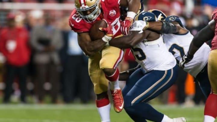 Sep 12, 2016; Santa Clara, CA, USA; San Francisco 49ers running back Carlos Hyde (28) runs the ball against the Los Angeles Rams in the fourth quarter at Levi