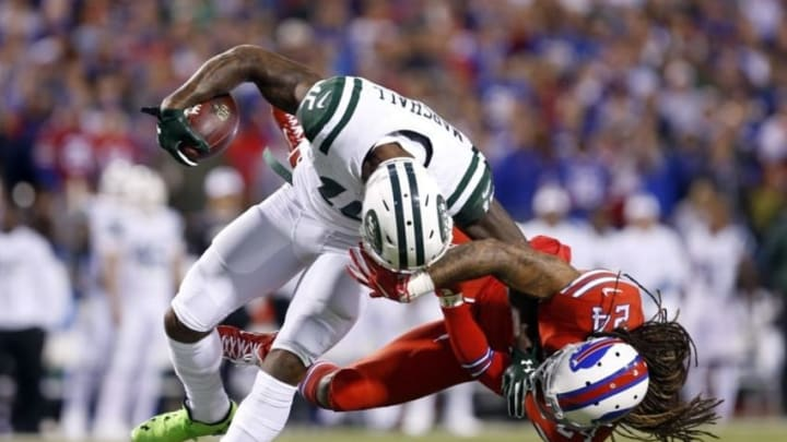 Sep 15, 2016; Orchard Park, NY, USA; Buffalo Bills cornerback Stephon Gilmore (24) gets called for a face mask on New York Jets wide receiver Brandon Marshall (15) during the first half at New Era Field. Mandatory Credit: Timothy T. Ludwig-USA TODAY Sports