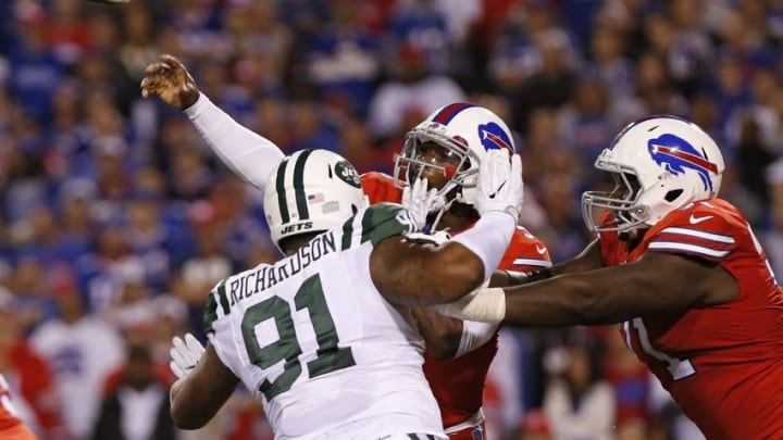 Sep 15, 2016; Orchard Park, NY, USA; New York Jets defensive end Sheldon Richardson (91) hits Buffalo Bills quarterback Tyrod Taylor (5) as he throws a pass during the first half at New Era Field. Mandatory Credit: Kevin Hoffman-USA TODAY Sports