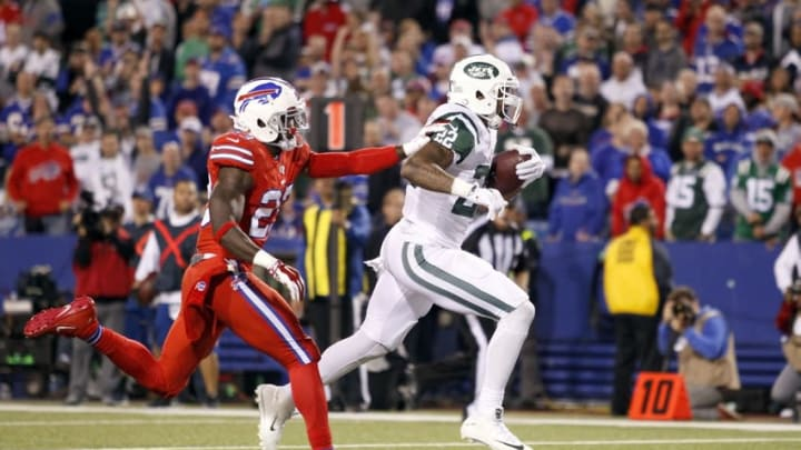 Sep 15, 2016; Orchard Park, NY, USA; New York Jets running back Matt Forte (22) runs the ball in for a touchdown while being defended by Buffalo Bills strong safety Aaron Williams (23) during the second half at New Era Field. The Jets beat the Bills 37 to 31. Mandatory Credit: Timothy T. Ludwig-USA TODAY Sports
