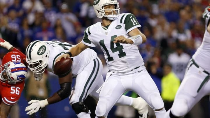 Sep 15, 2016; Orchard Park, NY, USA; New York Jets quarterback Ryan Fitzpatrick (14) throws a pass during the second half against the Buffalo Bills at New Era Field. The Jets beat the Bills 37 to 31. Mandatory Credit: Timothy T. Ludwig-USA TODAY Sports