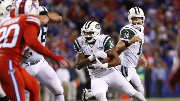 Sep 15, 2016; Orchard Park, NY, USA; New York Jets running back Matt Forte (22) runs for a touchdown after taking a handoff from quarterback Ryan Fitzpatrick (14) during the second half against the Buffalo Bills at New Era Field. The Jets beat the Bills 37-31. Mandatory Credit: Kevin Hoffman-USA TODAY Sports