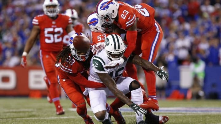 Sep 15, 2016; Orchard Park, NY, USA; New York Jets wide receiver Brandon Marshall (15) has a pass knocked down by the Buffalo Bills defense during the second half at New Era Field. The Jets beat the Bills 37-31. Mandatory Credit: Kevin Hoffman-USA TODAY Sports
