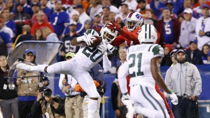 Sep 15, 2016; Orchard Park, NY, USA; New York Jets cornerback Marcus Williams (20) intercepts a pass intended for Buffalo Bills wide receiver Sammy Watkins (14) during the second half at New Era Field. The Jets beat the Bills 37-31. Mandatory Credit: Kevin Hoffman-USA TODAY Sports