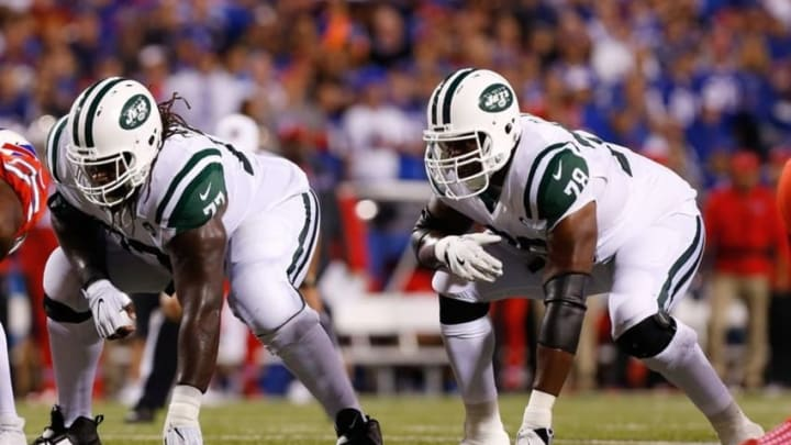 Sep 15, 2016; Orchard Park, NY, USA; New York Jets guard James Carpenter (77) and tackle Ryan Clady (78) during the game against the Buffalo Bills at New Era Field. Mandatory Credit: Kevin Hoffman-USA TODAY Sports