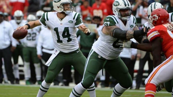 Sep 25, 2016; Kansas City, MO, USA; New York Jets quarterback Ryan Fitzpatrick (14) drops back to pass against the Kansas City Chiefs in the first half at Arrowhead Stadium. Mandatory Credit: John Rieger-USA TODAY Sports