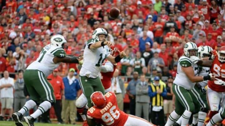 Sep 25, 2016; Kansas City, MO, USA; New York Jets quarterback Ryan Fitzpatrick (14) throws an interception under pressure from Kansas City Chiefs defensive end Jaye Howard (96) in the second half at Arrowhead Stadium. Kansas City won 24-3. Mandatory Credit: John Rieger-USA TODAY Sports