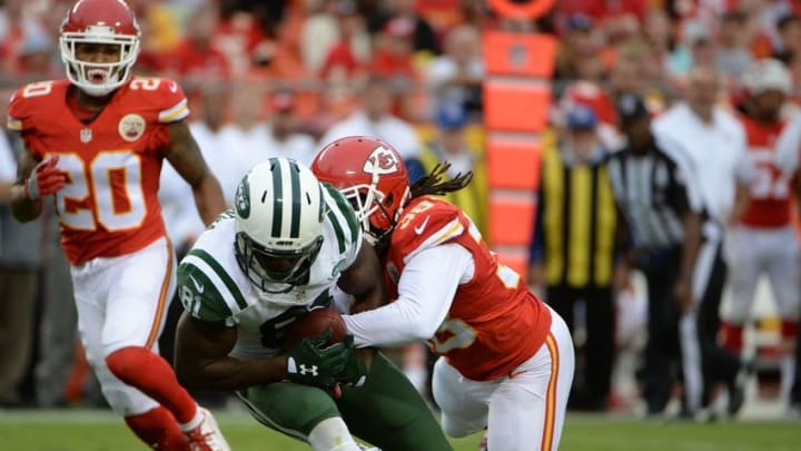 Sep 25, 2016; Kansas City, MO, USA; New York Jets wide receiver Quincy Enunwa (81) is tackled by Kansas City Chiefs free safety Ron Parker (38) in the second half at Arrowhead Stadium. Kansas City won 24-3. Mandatory Credit: John Rieger-USA TODAY Sports