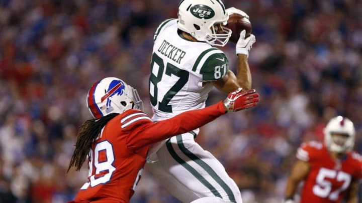 Sep 15, 2016; Orchard Park, NY, USA; New York Jets wide receiver Eric Decker (87) jumps to make a catch while being defended by Buffalo Bills cornerback Ronald Darby (28) during the second half at New Era Field. The Jets beat the Bills 37 to 31. Mandatory Credit: Timothy T. Ludwig-USA TODAY Sports