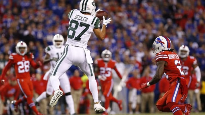 Sep 15, 2016; Orchard Park, NY, USA; New York Jets wide receiver Eric Decker (87) catches a pass in front of Buffalo Bills defensive back Nickell Robey (21) during the second half at New Era Field. The Jets beat the Bills 37-31. Mandatory Credit: Kevin Hoffman-USA TODAY Sports